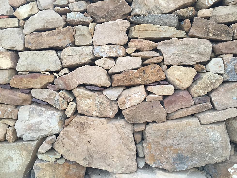 Détail de mur en pierre sèche